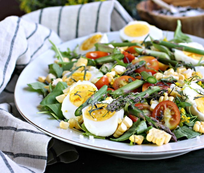 Recipe for a salad with eggs, asparagus, corn and peppery mizuna greens.