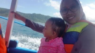 naik kapal ke pulau pamutusan dan pulau pasumpahan
