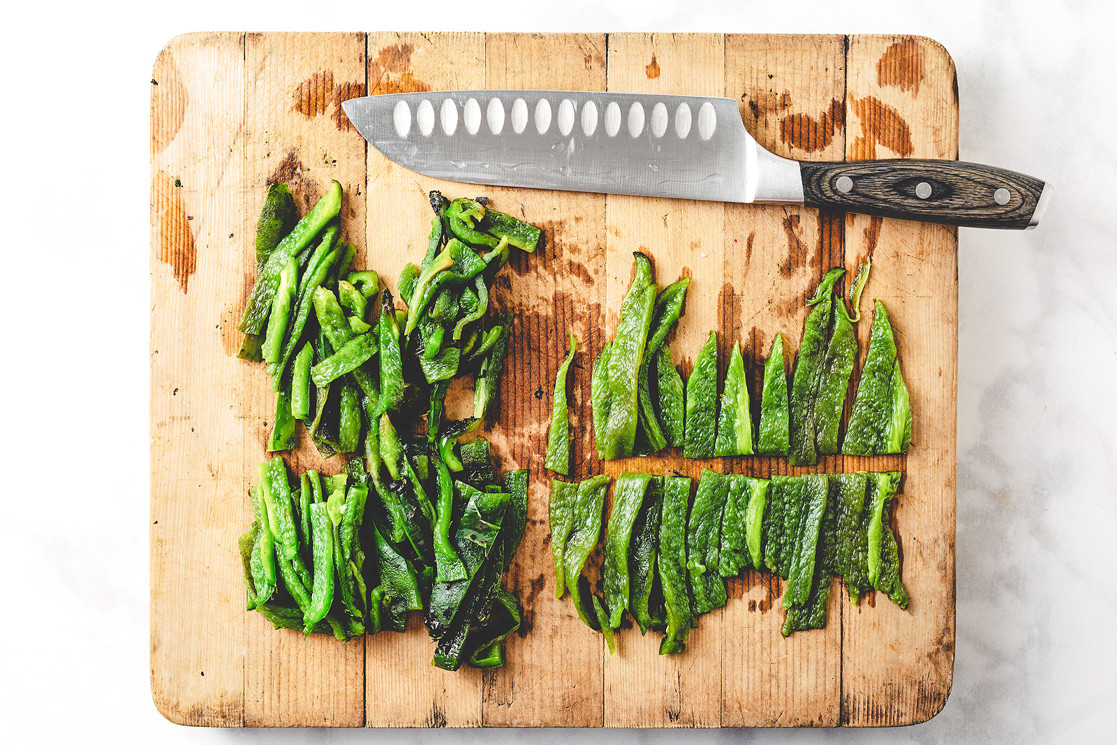 Roasted poblano peppers cut into strips.