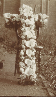 Cross of white arum lilies and hyacinths in the shape of a cross