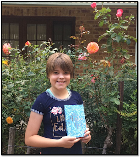 Sophie Harris holding The Austen Girls by Lucy Worsley