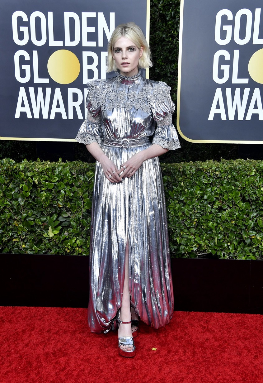 Lucy Boynton shimmers in eye-catching silver gown with high neckline