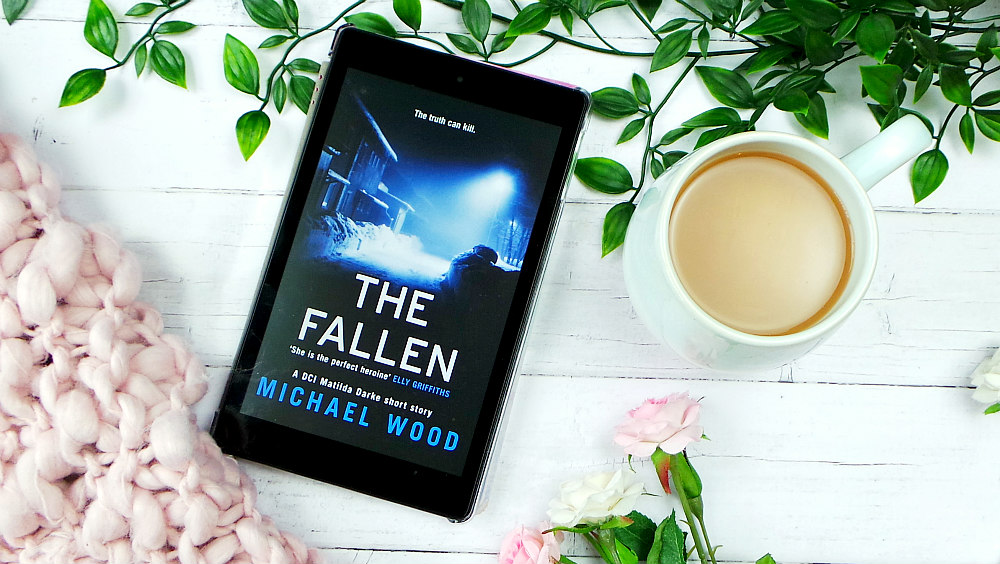 Kindle fire showing the cover of The Fallen. The cover has a dimly lit snow covered street