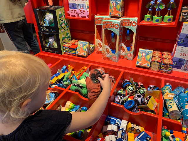 Child looking at toys in Pollock Toy Museum Covent Garden