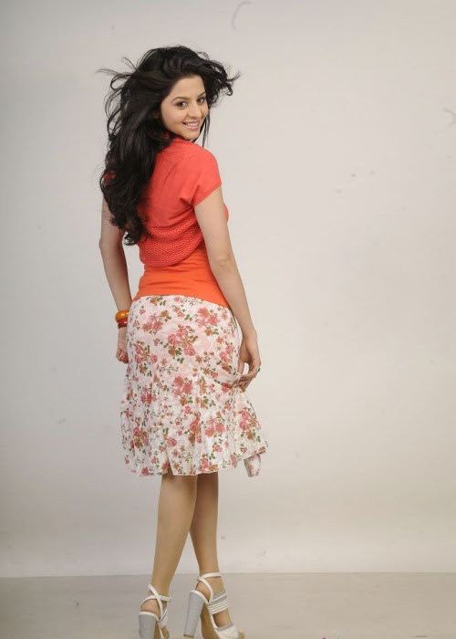 Tollywood Beauty Vedhika Hot Smiling Face Stills In Mini Orange Dress