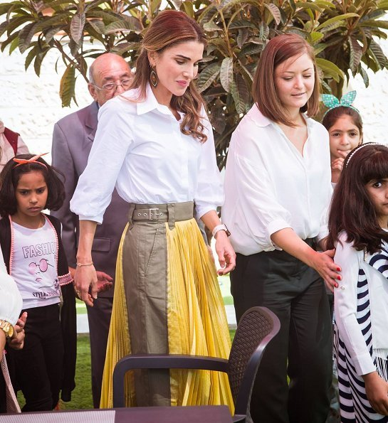 Queen Rania wore Sacai pleated midi skirt, Maison Makarem balloon shirt, Dior pumps and she carried Marni Trunk shoulder bag