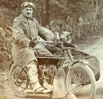 Vintage photo of rider on flat-tank Royal Enfield motorcycle.