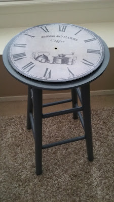 DIY converted stool into a coffee table with stenciled clock