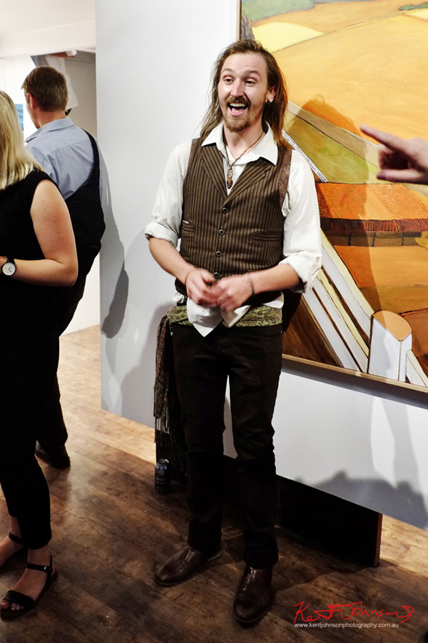 Artist Neil Tomkins at the grand opening of The New Standard Gallery. Photo by Kent Johnson for Street Fashion Sydney.