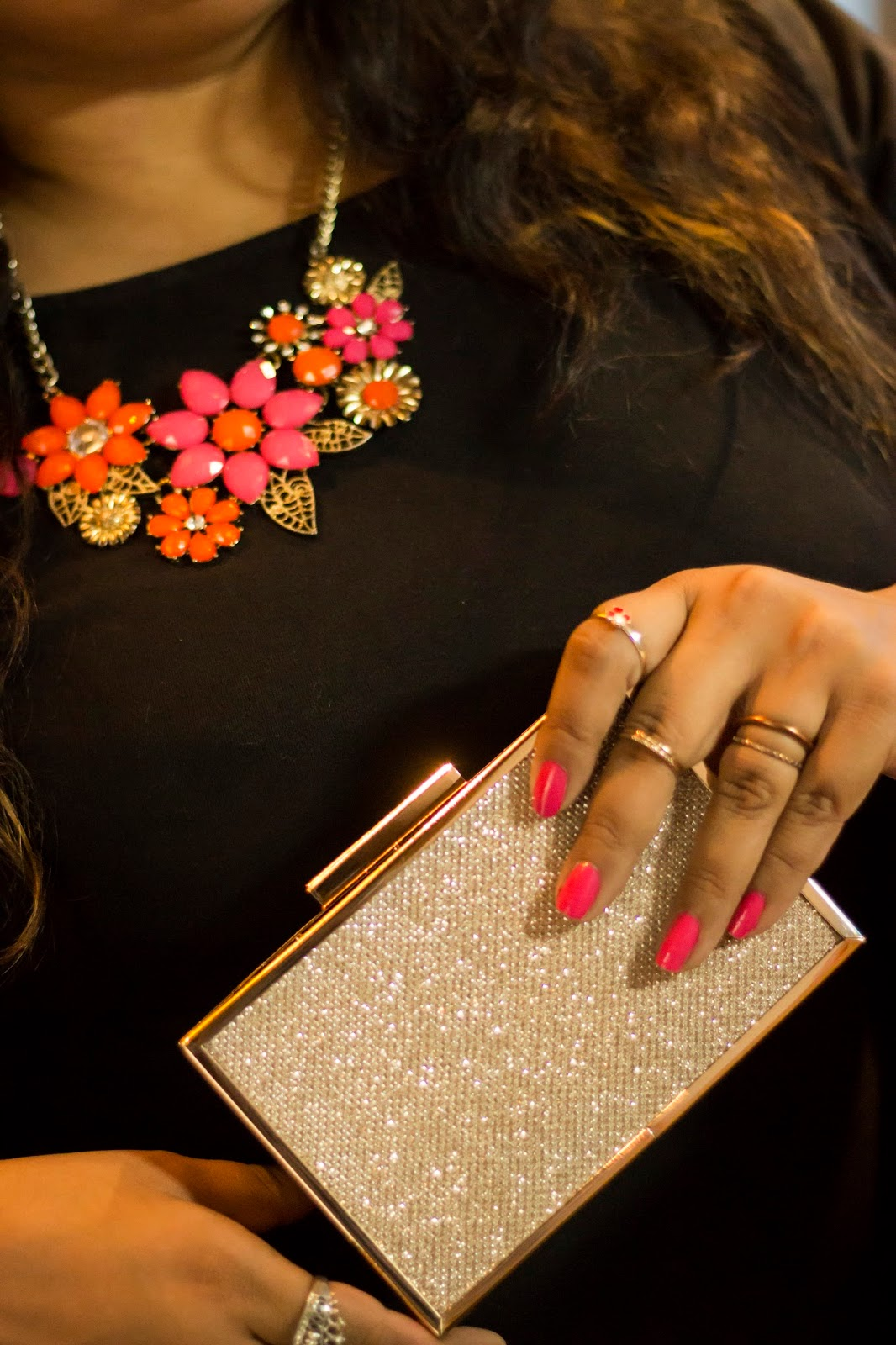 statement neckpiece pink nails shimmer party clutch