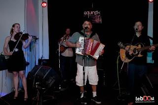"Cambodia only. Justin Ringsak ""Olaf"" (mandolin, trumpet) Frank Ruffolo ""Gino"" (accordion) Matt Schumacher ""Schlotzki"" (bajo quinto) Uncle ""Snuffy"" Jesse (trombone) Chris Davis ""Chester"" (fiddle) Cambodia only. Renee Adelaide ""Blanche"" (fiddle) Garrett Smith ""Smitty"" (sousaphone)"