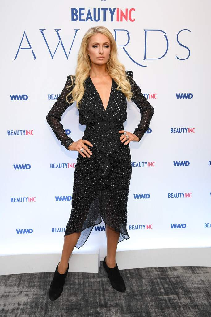 Paris Hilton takes the plunge in polka-dotted dress at the WWD Beauty Awards in New York