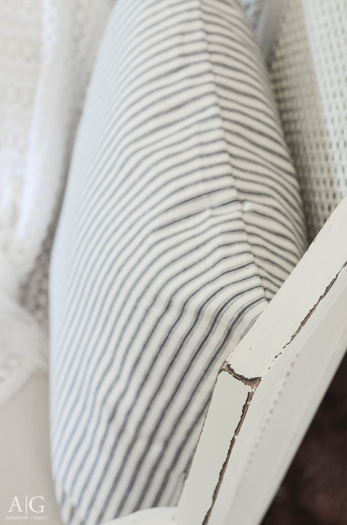 Perfect distressing gives the look of authentic wear to this chair.