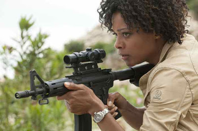 Naomie Harris as Eve aka Mrs. Moneypenny (taking a shot at Bond) in Skyfall (2012),  Directed by Sam Mendes