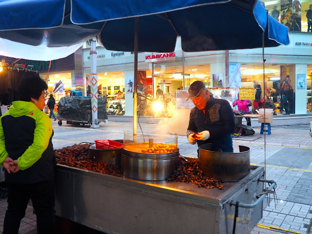 Street food seller roasting chestnuts in Seomyeon, Busan, South Korea