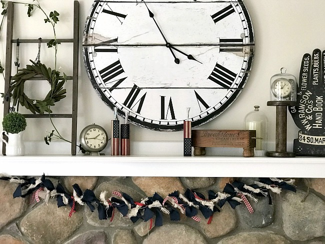 Large mantel with clock and rag garland