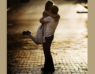 Romantic-girl-jumps-and-hugs-boyfriend-and-kisses-him-image.jpg