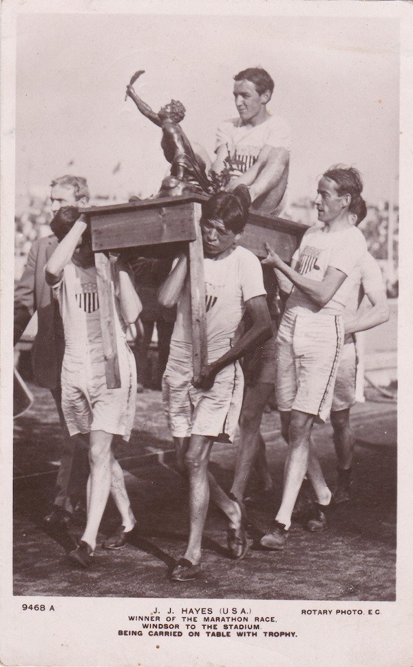 JJ Hayes, American marathon runner, carried on a table by his teammates, after being awarded the win in the  Olympics 1908. Your Russians are missing and other stories about past Olympics. marchmatron.com