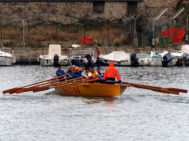 Boat, gozzo, rowers of the quarter San Marco Pontino, Livotno