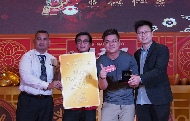 Trader Kuan Boo Jing won the BIGGEST prize