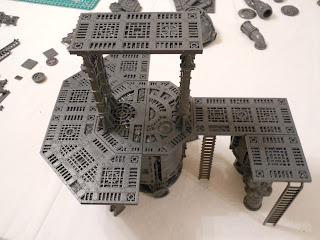 A two tier structure made with Shadow War: Armageddon scenery