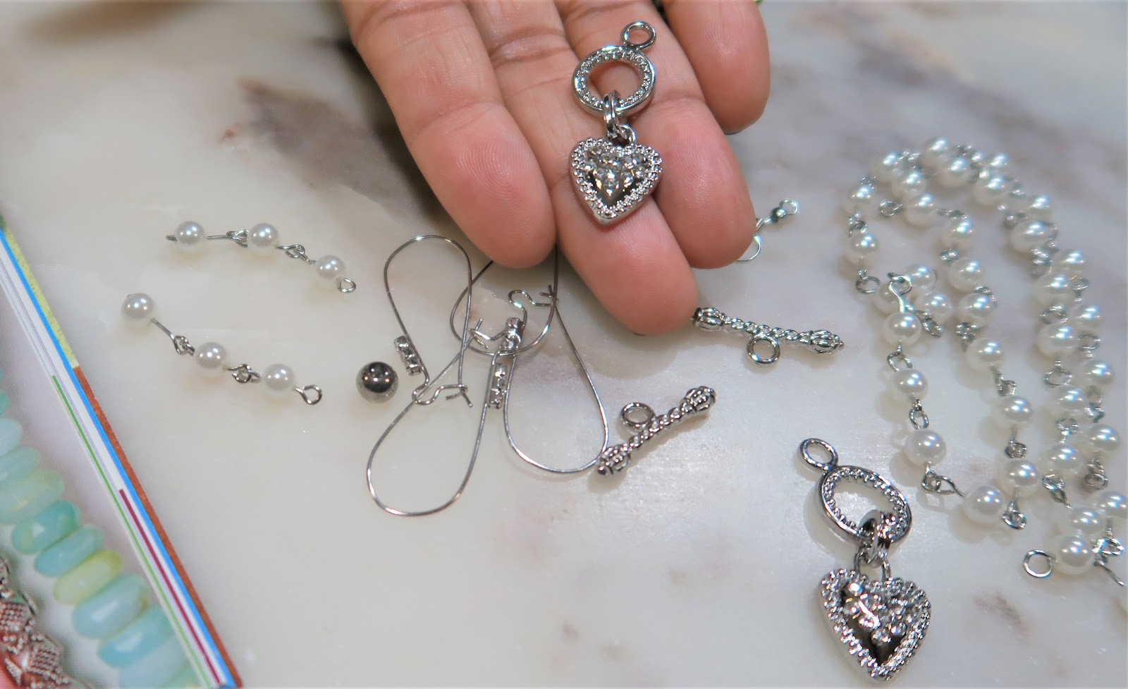 Image: Tangie Bell showing another way to make earring by using toggles that are meant to make necklaces.