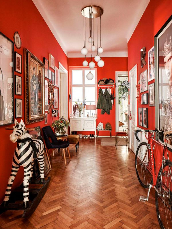 Red foyer with gallery wall display and home decor