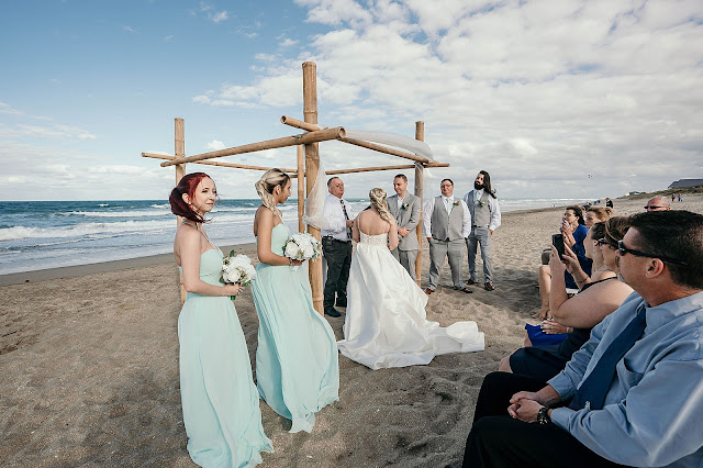 Bride and Groom at Beach Ceremony with waves in the background