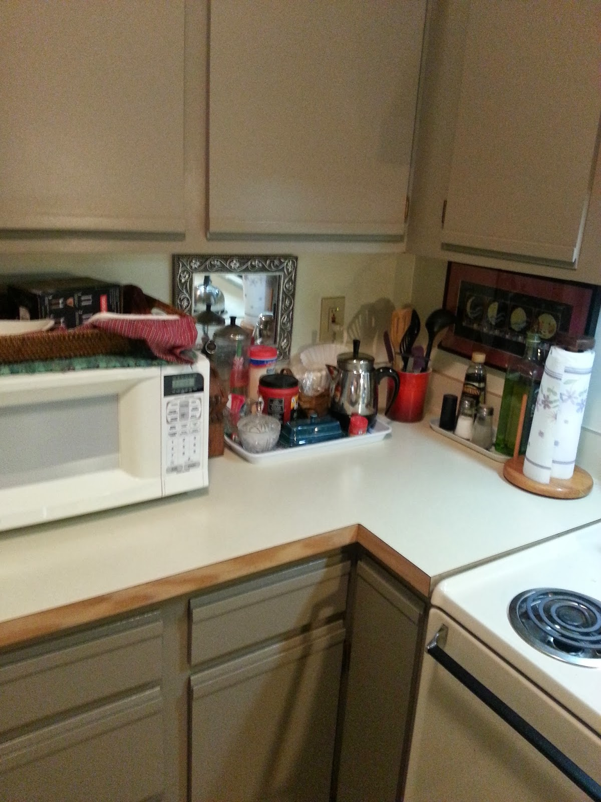foobella designs Painting Laminate Kitchen Cabinets Done