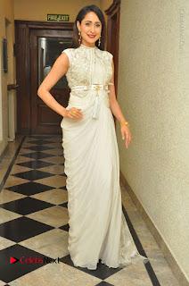 Actress Pragya Jaiswal Stills in Beautiful White Dress at turodu Audio Launch  0067.JPG