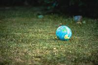 Small Globe - Photo by Guillaume de Germain on Unsplash