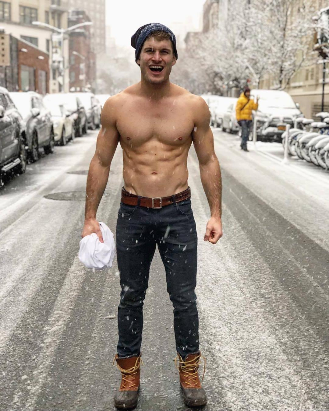 brave-shirtless-fit-bro-vline-body-abs-jeans-beanie-freezing-outside-snowing-city-street