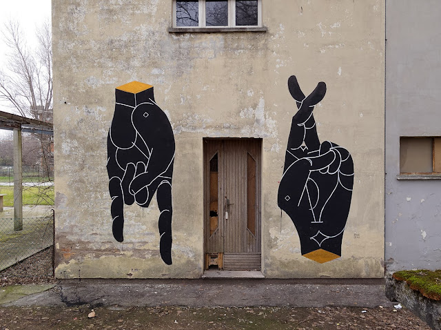 New Hands mural by Italian street artist Basik in the city of Rimini in Italy. 1