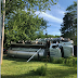 Overturned septic tank truck results in DWI arrest