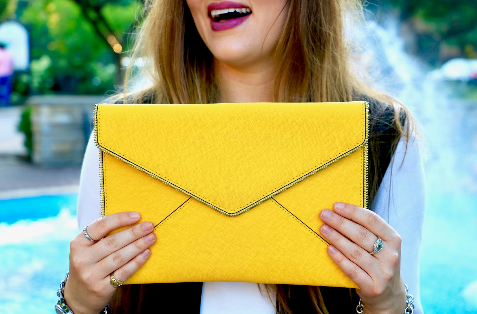 NYC fashion blogger Kathleen Harper of Kat's Fashion Fix with yellow Rebecca Minkoff clutch