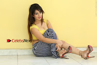 Cute Telugu Actress Shunaya Solanki High Definition Spicy Pos in Yellow Top and Skirt  0307.JPG