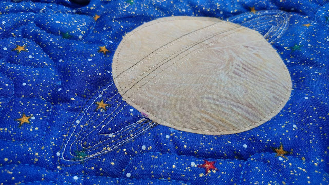 Outer space quilt by six year old boy