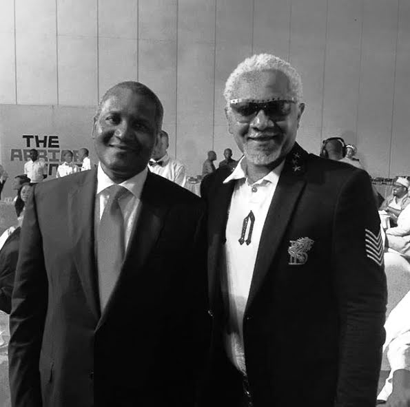 Awilo Longomba with the Africa's richest man Dangote