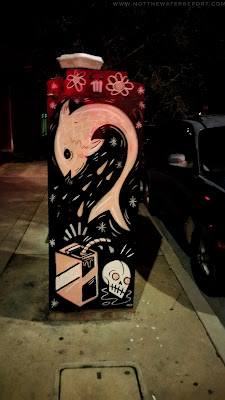 A wild fish painted on an Adams Avenue electrical box.