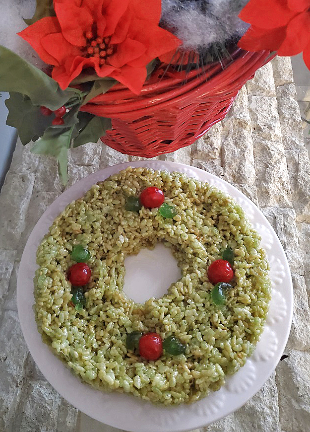 this is a rice krispies treat shaped into a wreath with cherries