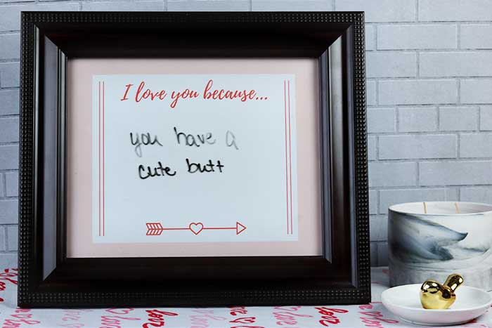 This is an easy Valentine's Day DIY project for home. Use free printables to make an 8x10 frame dry erase sign. Use as decorations or for a gift for him, for her, or for kids. This can be romantic or funny or change it daily. This is a cheap Happy Valentine's Day craft that just needs paper and a cute frame.  Save money with homemade crafts and ideas like this cute sign. #sign #printable #valentinesday