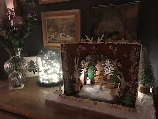 This is another one of my personal Gingerbread construction designs.  I've always wanted to make a diorama style gingerbread theatre and although it didn't photograph very well, I was happy with the overall effect.  It looks really impressive with the lighting coming through the sides