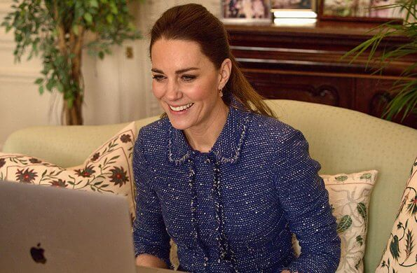 Kate Middleton wore a sparkle tweed ruffle jacket from Rebecca Taylor. Missoma gold mini pyramid charm hoop earrings
