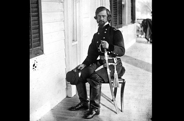 Union General Isaac I. Stevens, seated on a porch in March of 1862, near Beaufort, South Carolina. Stevens, formerly the first governor of Washington Territory, was killed in action at the Battle of Chantilly on September 1, 1862 after picking up the fallen regimental colors of his old regiment, shouting