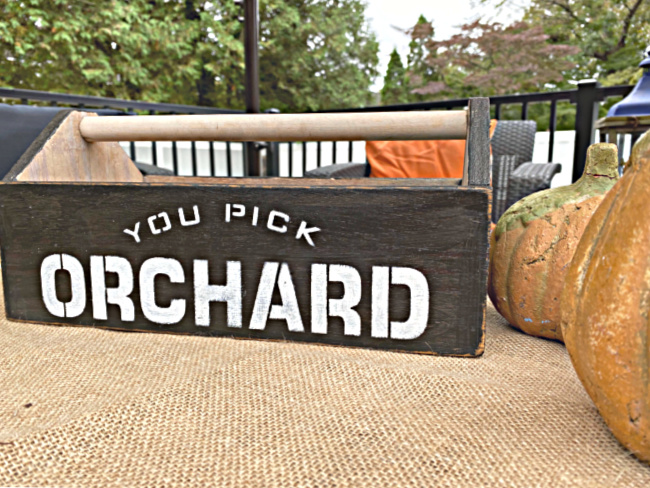 wooden crate with orchard stencil