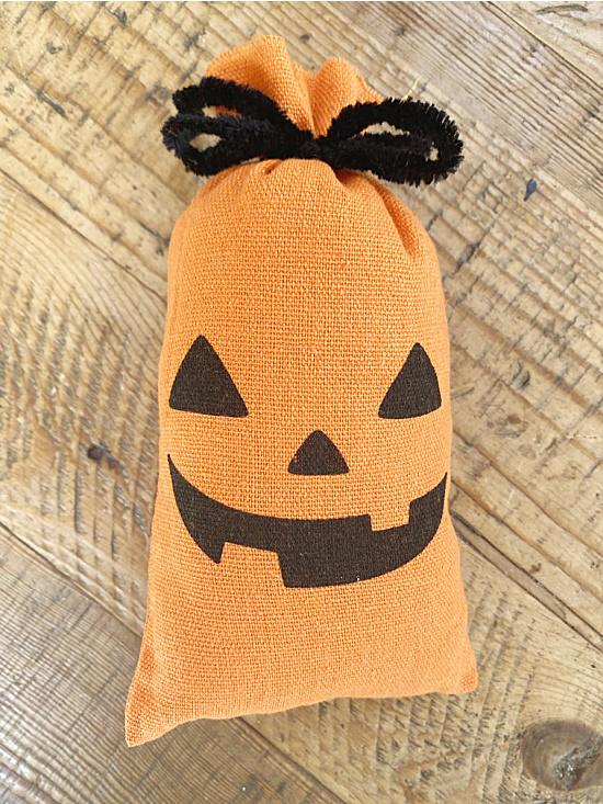 stuffed pumpkin fabric bag with black bow