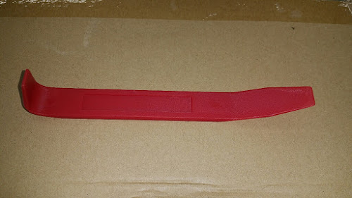 Trim Stick used to remove mirrors