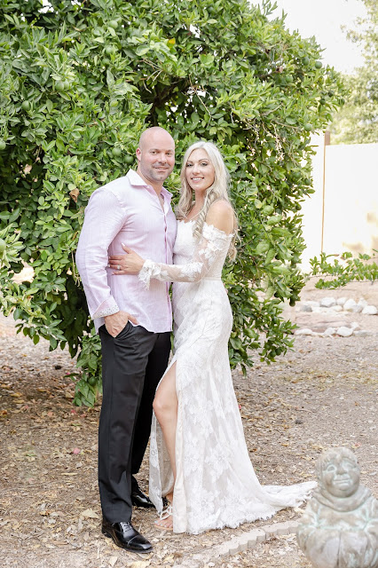 bride and groom photos in fruit tree orchard
