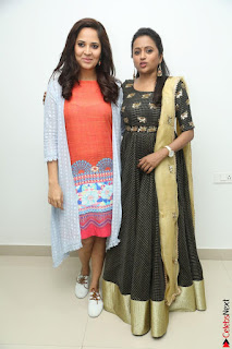 Actress Suma in Black Salwar Suit and Anusuya in orange Dress at winner movie press meet part 1 February 2017 (6).JPG