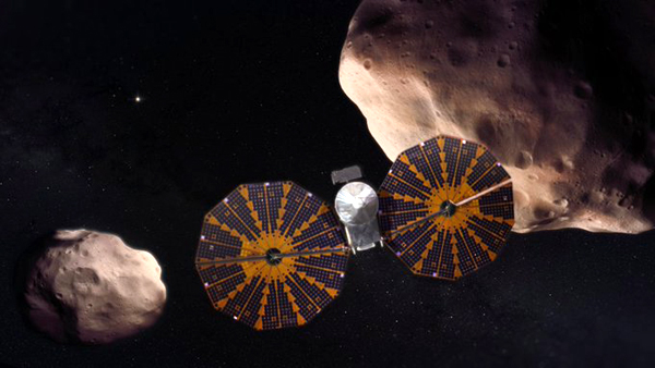 An artist's concept of NASA's Lucy spacecraft venturing past the Trojan asteroid Patroclus and its binary companion Menoetius near Jupiter's orbit.